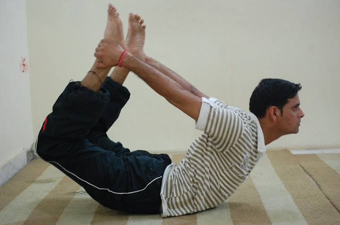 Dhanurasana (power yoga)